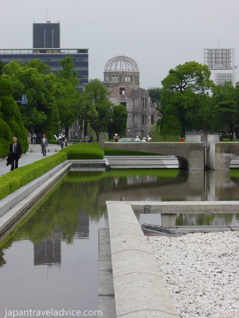 Peace Flame with the A-Bomb Dome in background